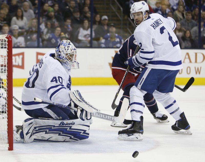 Toronto Maple Leafs' Garret Sparks, left, makes a savbe as teammate Ron Hainsey looks for the rebound during the second period of an NHL hockey game against the Columbus Blue Jackets on Friday, Dec. (AP Photo/Jay LaPrete)