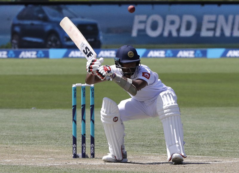 Sri Lanka's Dinesh Chandimal ducks to avoid a bouncer during play on day four of the second cricket test between New Zealand and Sri Lanka at Hagley Oval in Christchurch, New Zealand, Saturday, Dec. (AP Photo/Mark Baker)