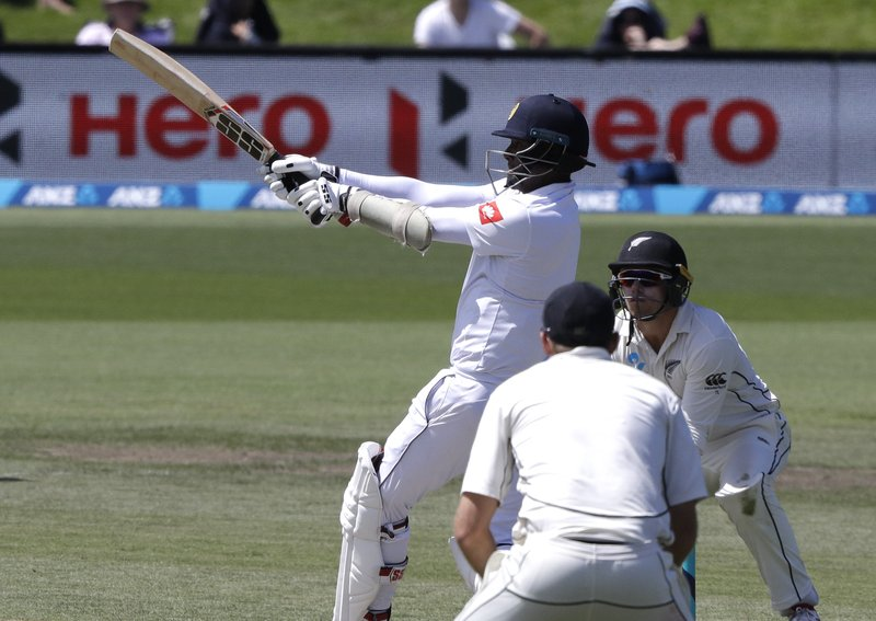 Sri Lanka's Angelo Mathews plays a pulls shot while batting during play on day four of the second cricket test between New Zealand and Sri Lanka at Hagley Oval in Christchurch, New Zealand, Saturday, Dec. (AP Photo/Mark Baker)