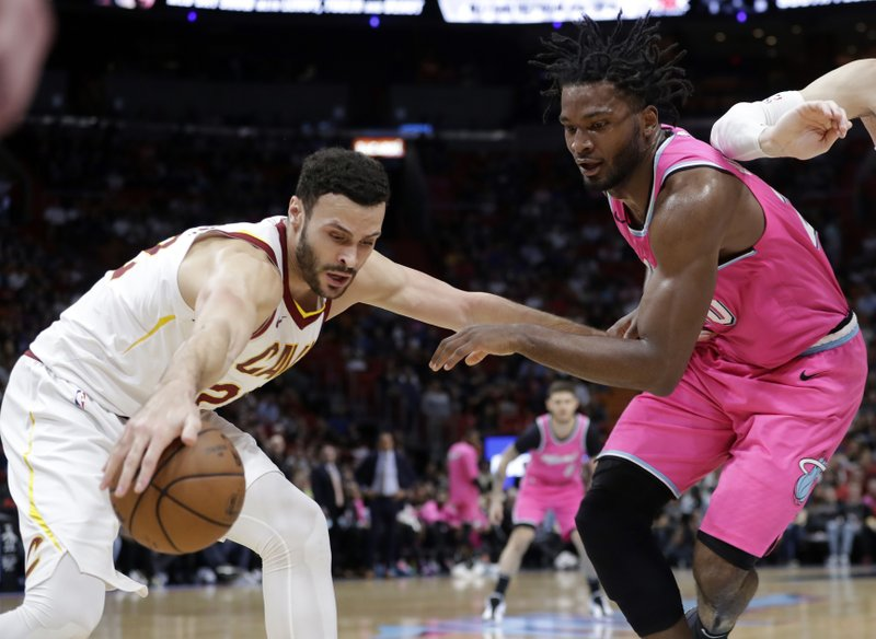 Cleveland Cavaliers forward Larry Nance Jr. (22) and Miami Heat forward Justise Winslow go for the ball during the first half of an NBA basketball game, Friday, Dec. (AP Photo/Lynne Sladky)