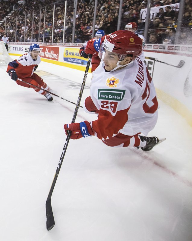 Russia's Ivan Muranov (23) falls in front of Czech Republic's David Kvasnicka (7) during the second period of a world junior hockey championships game in Vancouver, British Columbia, Friday, Dec. (Darryl Dyck/The Canadian Press via AP)