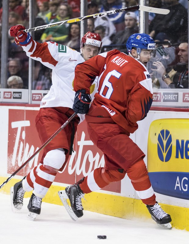 Czech Republic's Martin Kaut (16) and Russia's Dmitri Samorukov (5) collide during third-period IIHF world junior hockey championship game action in Vancouver, British Columbia, Friday, Dec. (Darryl Dyck/The Canadian Press via AP)