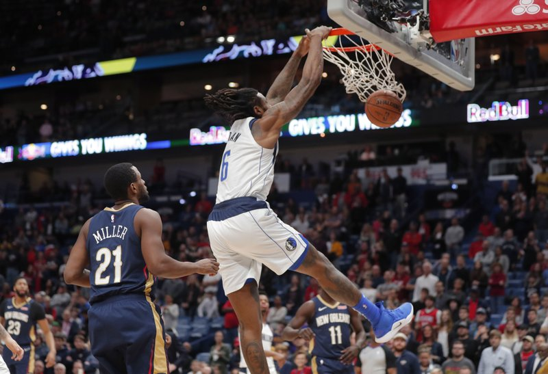 Dallas Mavericks center DeAndre Jordan (6) dunks in front of New Orleans Pelicans forward Darius Miller (21) during the first half of an NBA basketball game in New Orleans, Friday, Dec. (AP Photo/Gerald Herbert)