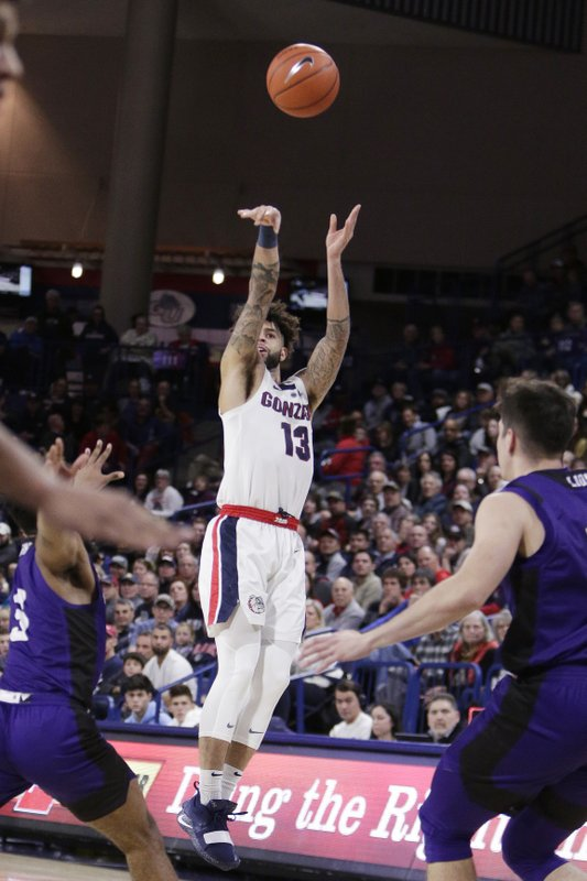 Gonzaga guard Josh Perkins (13) shoots in front of North Alabama guards Jamari Blackmon, left, and Aleksa Matic during the first half of an NCAA college basketball game in Spokane, Wash. (AP Photo/Young Kwak)