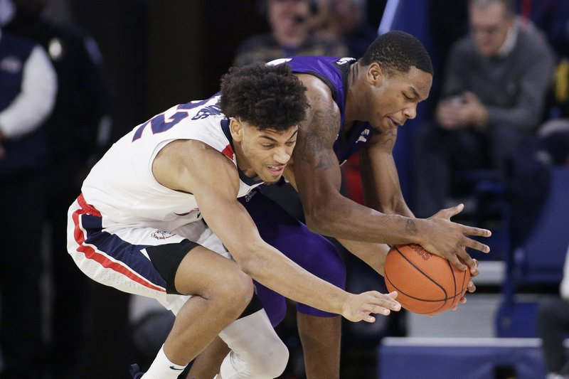 Gonzaga forward Jeremy Jones, left, and North Alabama guard Kendall Stafford go after the ball during the first half of an NCAA college basketball game in Spokane, Wash. (AP Photo/Young Kwak)