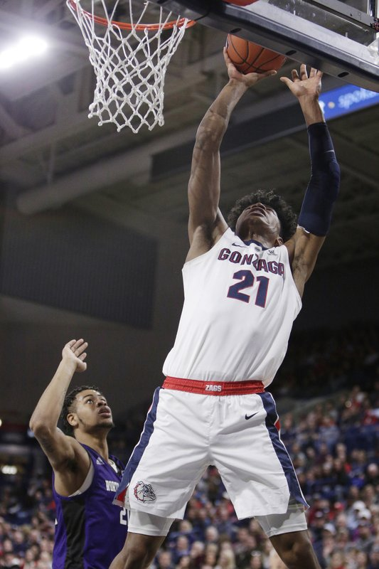 Gonzaga forward Rui Hachimura (21) shoots in front of North Alabama forward Emanuel Littles during the first half of an NCAA college basketball game in Spokane, Wash. (AP Photo/Young Kwak)