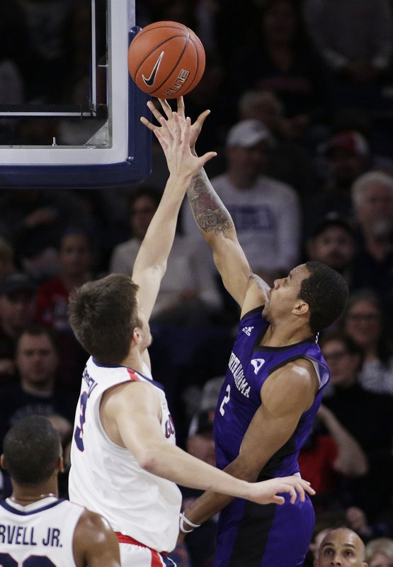 North Alabama guard Christian Agnew (2) shoots while defended by Gonzaga forward Filip Petrusev during the first half of an NCAA college basketball game in Spokane, Wash. (AP Photo/Young Kwak)
