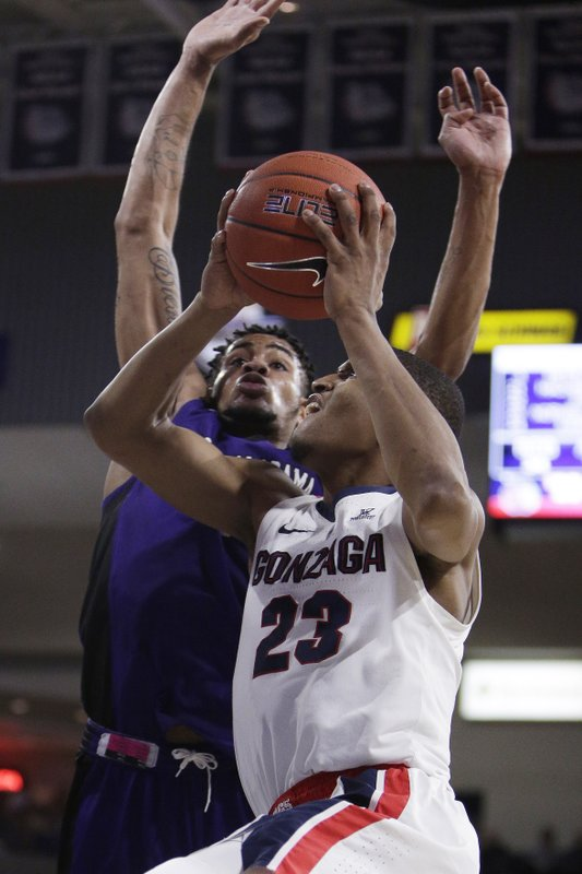 Gonzaga guard Zach Norvell Jr. (23) shoots while defended by North Alabama forward Emanuel Littles during the second half of an NCAA college basketball game in Spokane, Wash. (AP Photo/Young Kwak)