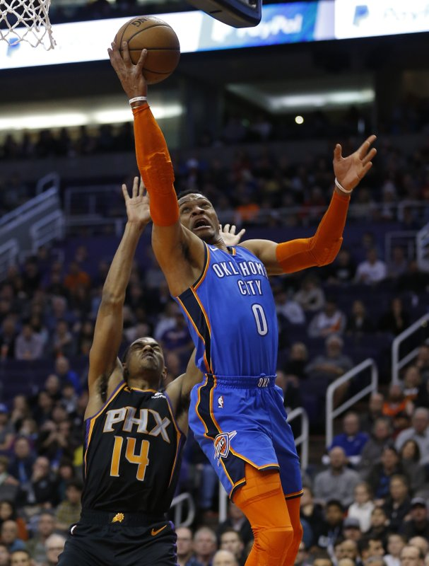 Oklahoma City Thunder guard Russell Westbrook (0) drives past Phoenix Suns guard De'Anthony Melton in the first half during an NBA basketball game, Friday, Dec. (AP Photo/Rick Scuteri)