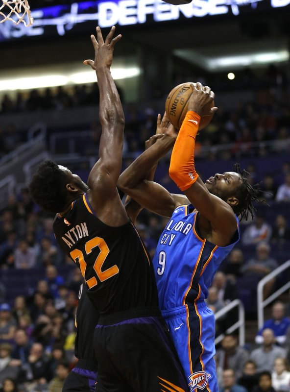 Oklahoma City Thunder forward Jerami Grant (9) shoots over Phoenix Suns center Deandre Ayton in the first half during an NBA basketball game, Friday, Dec. (AP Photo/Rick Scuteri)