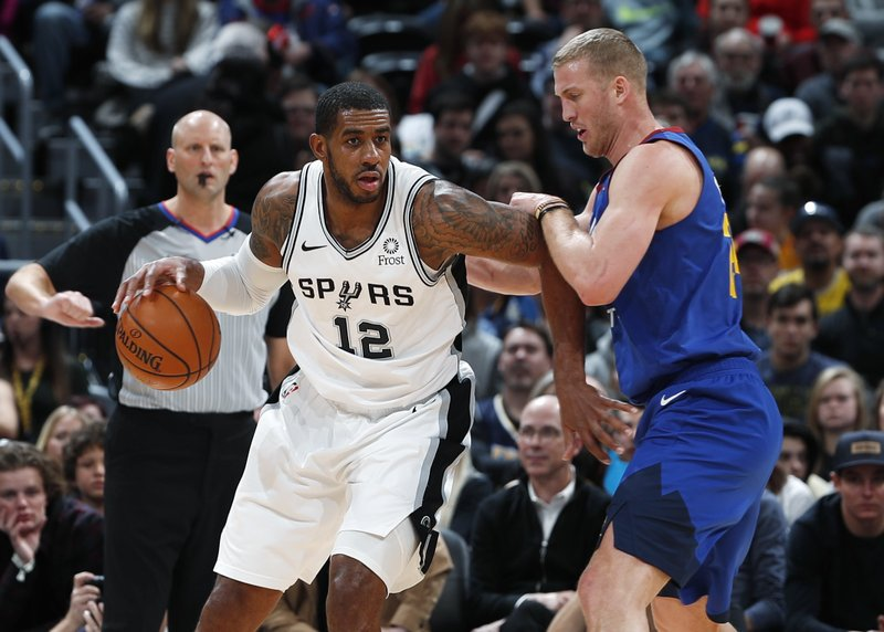San Antonio Spurs forward LaMarcus Aldridge, front left, works the ball inside as Denver Nuggets forward Mason Plumlee defends in the first half of an NBA basketball gsm Friday, Dec. (AP Photo/David Zalubowski)