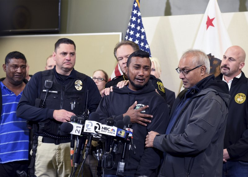 Reggie Singh, brother of Newman Police officer Ronil Singh is overcome with emotion as he thanks law enforcement after the arrest of suspect Gustavo Perez Arriaga and others Friday, Dec. (Joan Barnett Lee/The Modesto Bee via AP)