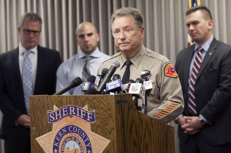 Kern County Sheriff Donny Youngblood, center, speaks at a news conference in Bakersfield, Calif., after suspect Gustavo Perez Arriaga surrendered and was taken into custody in Lamont, Calif. (Alex Horvath/The Californian via AP)