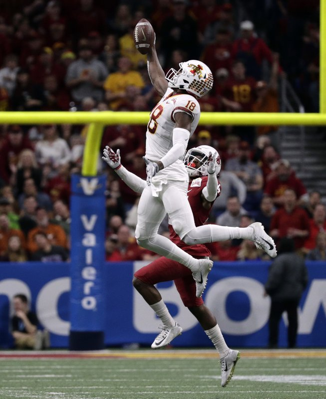 Iowa State wide receiver Hakeem Butler (18) makes a catch over Washington State safety Jalen Thompson during the second half of the Alamo Bowl NCAA college football game, Friday, Dec. (AP Photo/Eric Gay)
