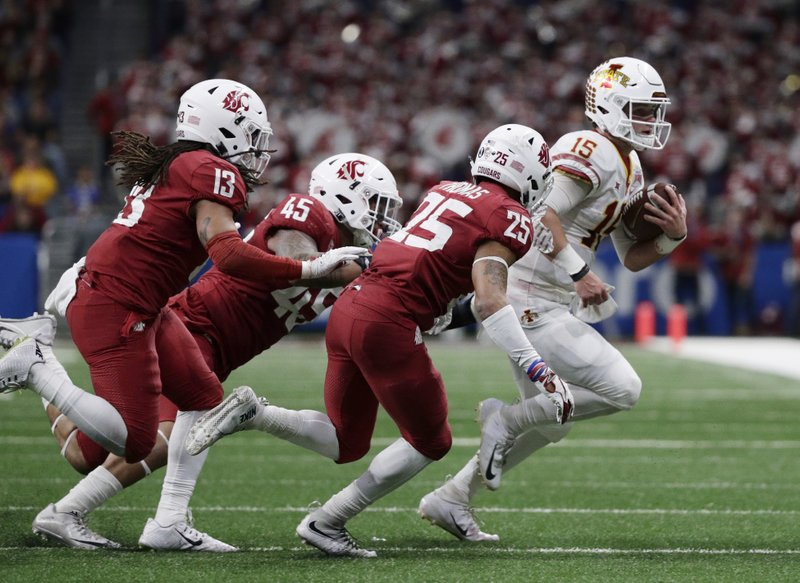 Iowa State quarterback Brock Purdy (15) is stopped short of a first down by Washington State defenders Skyler Thomas (25) and Logan Tago (45) during the second half of the Alamo Bowl NCAA college football game Friday, Dec. (AP Photo/Eric Gay)