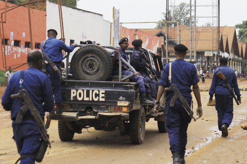 Congolese police move to quell protests in the Eastern Congolese town of Beni, Friday Dec. 28, 2018, as they demonstrate against the election postponed until March 2019, announced by Congo's electoral commission for Beni residents that is blamed on a deadly Ebola outbreak. (AP Photo/Al-hadji Kudra Maliro)