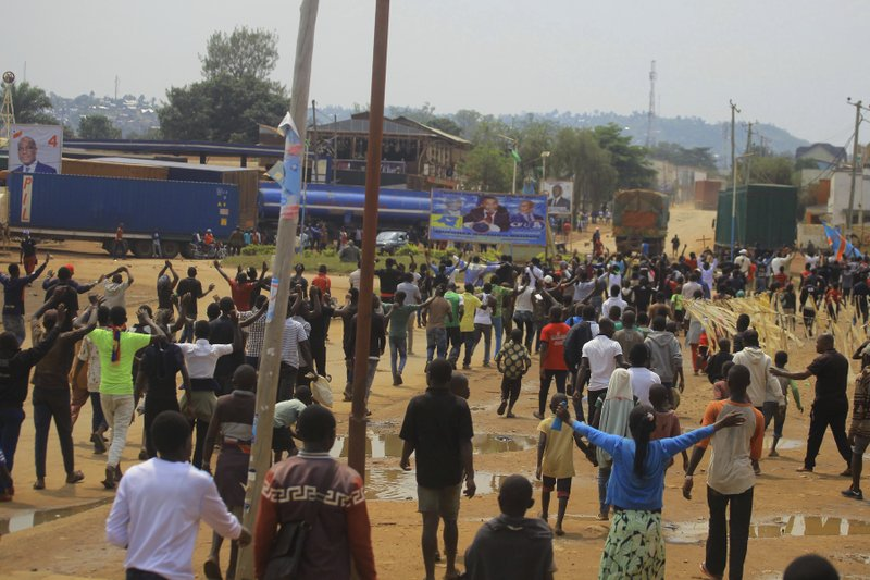 Protesters in the Eastern Congolese town of Beni, Friday Dec. 28, 2018, as they demonstrate against the election postponed until March 2019, announced by Congo's electoral commission for Beni residents that is blamed on a deadly Ebola outbreak. (AP Photo/Al-hadji Kudra Maliro)