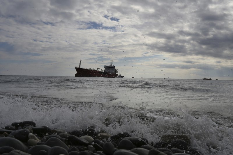 The Athlos tanker lays aground about 200-yards from the village of Zygi off the south coast of Cyprus, Saturday, Dec. (AP Photo/Petros Karadjias)