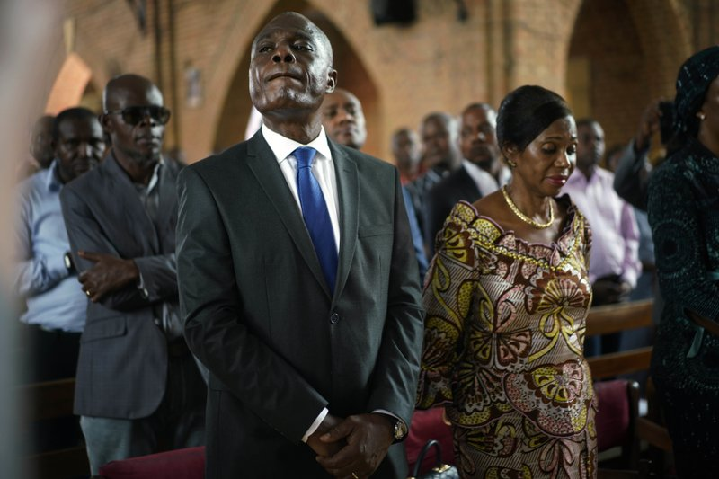 Congolese opposition presidential candidate Martin Fayulu attends a prayer service at Notre Dame du Congo cathedral in Kinshasa, Congo, Saturday Dec. (AP Photo/Jerome Delay)