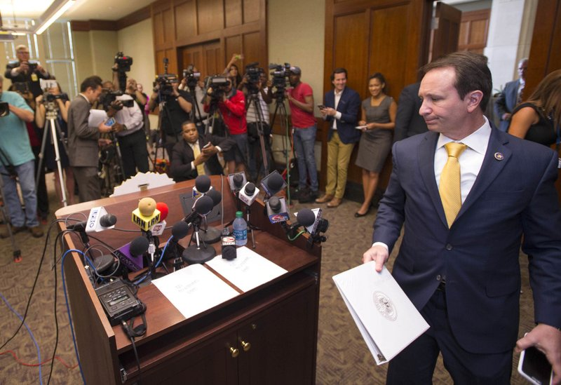 FILE - In this March 27, 2018, file photo, Louisiana Attorney General Jeff Landry approaches the lectern to speak, to report his office's findings, that there were no state criminal charges to be prosecuted against Baton Rouge Police Department officers Blane Salamoni and Howie Lake II, who were involved in the fatal shooting of Alton Sterling, a black man, in July 2016 outside a convenience store. (Travis Spradling/The Advocate via AP, File)