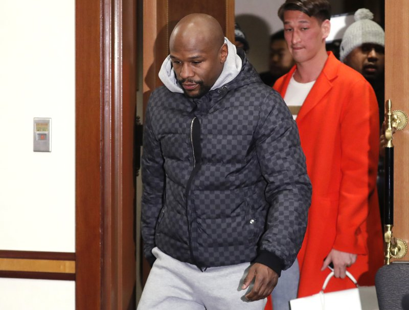 Floyd Mayweather Jr. walks into venue for a news conference in Tokyo Saturday, Dec. 29, 2018. Mayweather is scheduled to fight Japanese kickboxer Tenshin Nasukawa in a three-round exhibition match in Japan on New Year's Eve. (AP Photo/Eugene Hoshiko)