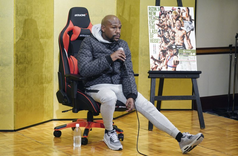 Floyd Mayweather Jr. listens a question from media during a news conference in Tokyo Saturday, Dec. 29, 2018. (AP Photo/Eugene Hoshiko)