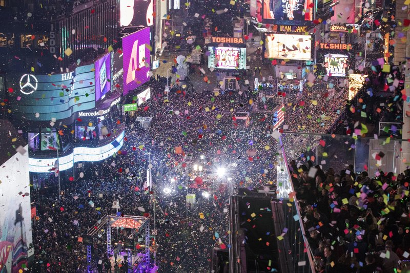 FILE - In this Jan. 1, 2017 file photo, revelers celebrate the new year as confetti flies over New York's Times Square. (AP Photo/Mary Altaffer, File)