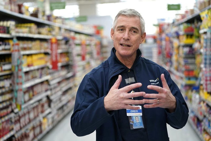 FILE - In this Nov. 9, 2018, file photo, Walmart U.S. President and CEO Greg Foran talks about the technology the company is using to keep shelves stocked at a Walmart Supercenter in Houston. (AP Photo/David J. Phillip, File)