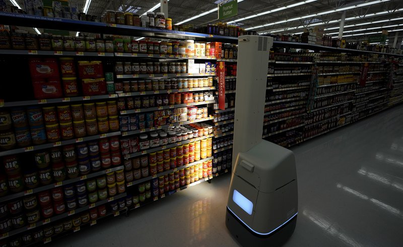 FILE - In this Nov. 9, 2018, file photo, a Bossa Nova robot scans shelves to help provide associates with real-time inventory data at a Walmart Supercenter in Houston. (AP Photo/David J. Phillip, File)