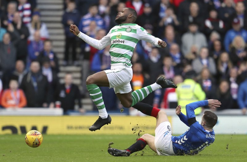 Celtic's Olivier Ntcham, left, and Rangers' Andrew Halliday clash during their Scottish Premiership soccer match at Ibrox Stadium in Glasgow, Scotland, Saturday Dec. (Andrew Milligan/PA via AP)