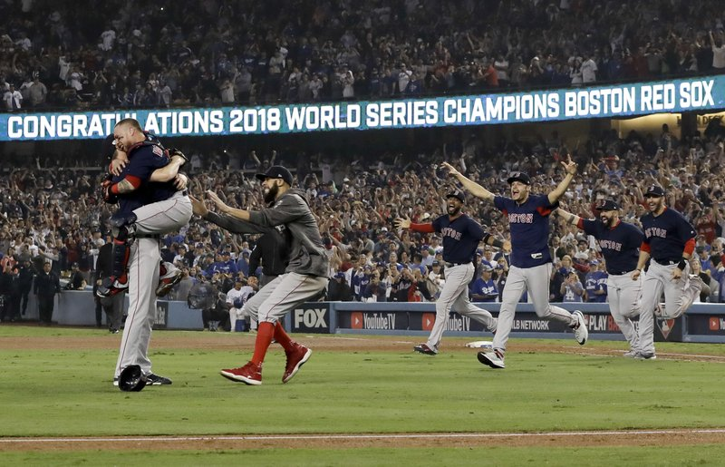 FILE - In this Oct. 28, 2018, file photo, the Boston Red Sox celebrate after Game 5 of baseball's World Series against the Los Angeles Dodgers in Los Angeles. (AP Photo/David J. Phillip)