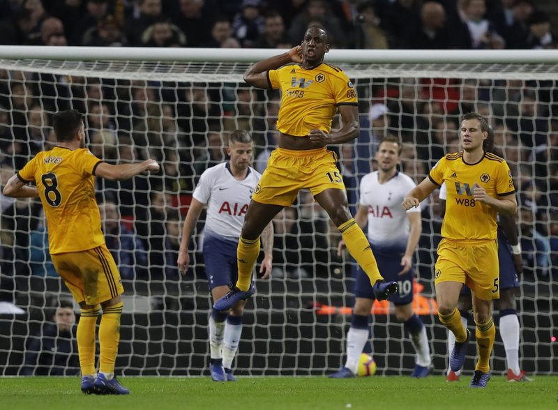 Wolverhampton Wanderers Willy Boly leaps up as he celebrates scoring his sides 1st goal during their English Premier League soccer match between Tottenham Hotspur and Wolverhampton Wanderers at Wembley stadium in London, Saturday, Dec. (AP Photo/Kirsty Wigglesworth)