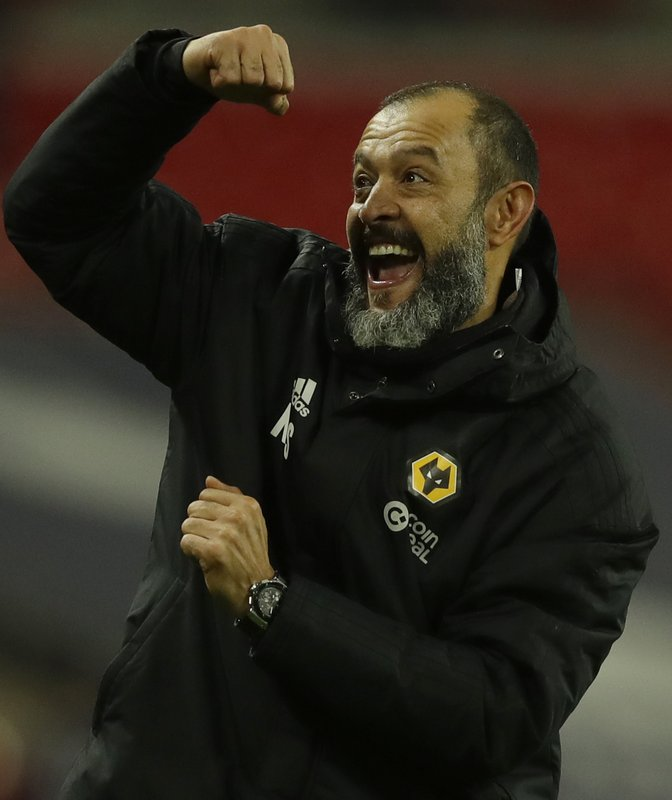 Wolverhampton Wanderers head coach Nuno Espirito Santo celebrates towards his teams fans after his side defeated Tottenham Hotspur 3-1, in their English Premier League soccer match between Tottenham Hotspur and Wolverhampton Wanderers at Wembley stadium in London, Saturday, Dec. (AP Photo/Kirsty Wigglesworth)