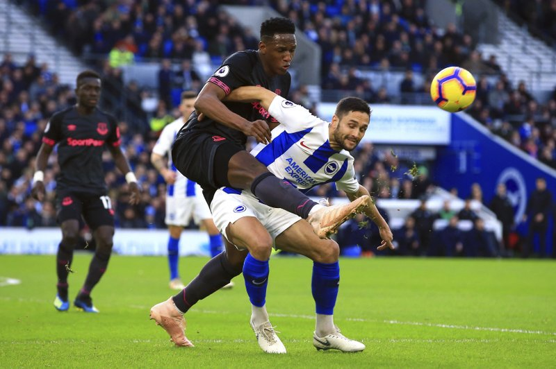 Brighton & Hove Albion's Florin Andone, right, and Everton's Yerry Mina during their English Premier League soccer match at the AMEX Stadium in Brighton, England, Saturday Dec. (Mark Kerton/PA via AP)