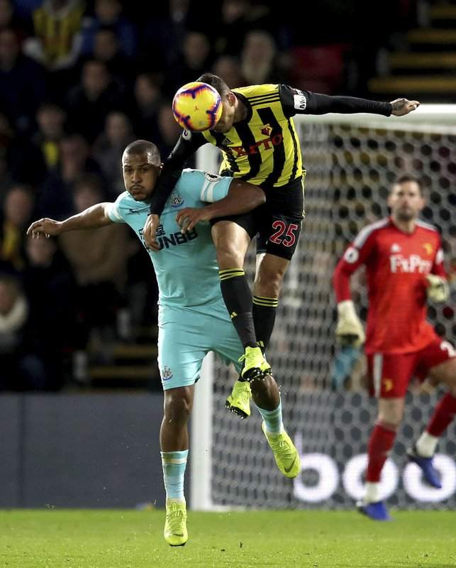 Newcastle United's Salomon Rondon, left, and Watford's Jose Holebas during their English Premier League soccer match, at Vicarage Road in Watford, London, Saturday Dec. (Adam Davy/PA via AP)