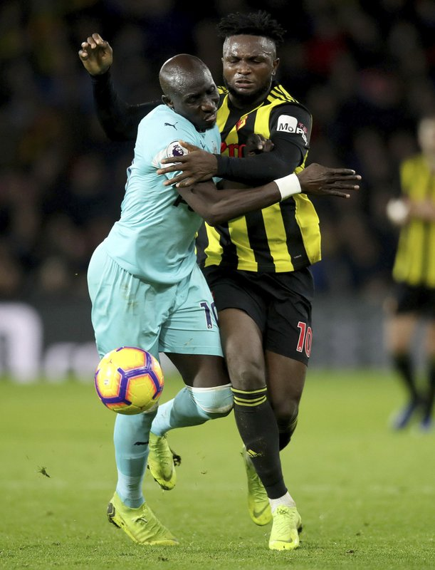 Newcastle United's Mohamed Diame, left, chases after the ball with Watford's Isaac Success, during their English Premier League soccer match, at Vicarage Road in Watford, London, Saturday Dec. (Adam Davy/PA via AP)