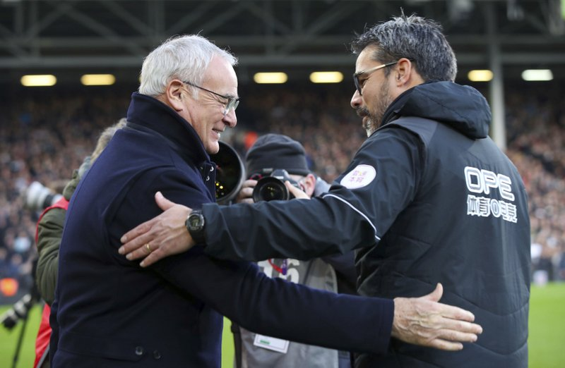 Fulham Manager Claudio Ranieri, left, and Huddersfield Town manager David Wagner shake hands ahead of their English Premier League soccer match at Craven Cottage in London, Saturday Dec. (Yui Mok/PA via AP)