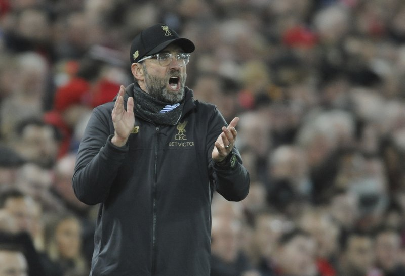 Liverpool's manager Jurgen Klopp gestures to his players during the English Premier League soccer match between Liverpool and Arsenal at Anfield in Liverpool, England, Saturday, Dec. (AP Photo/Rui Vieira)