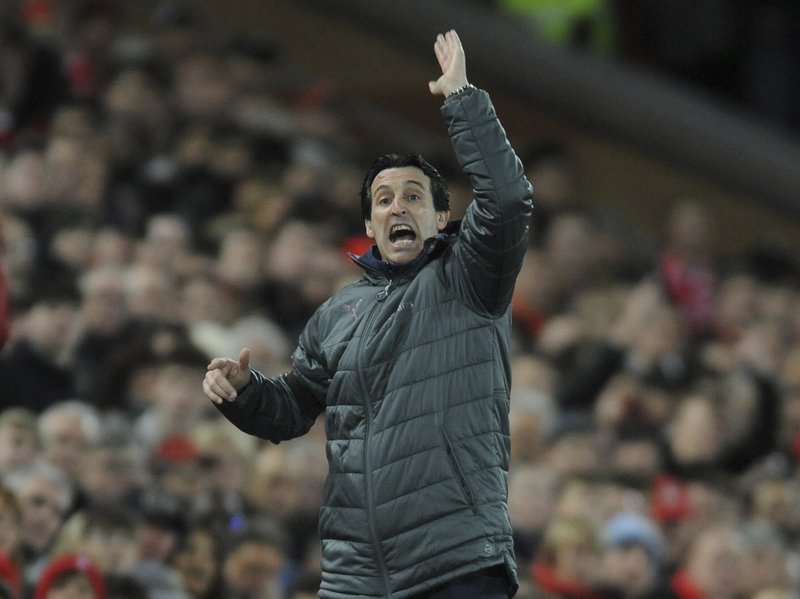 Arsenal's manager Unai Emery gestures to his players during the English Premier League soccer match between Liverpool and Arsenal at Anfield in Liverpool, England, Saturday, Dec. (AP Photo/Rui Vieira)