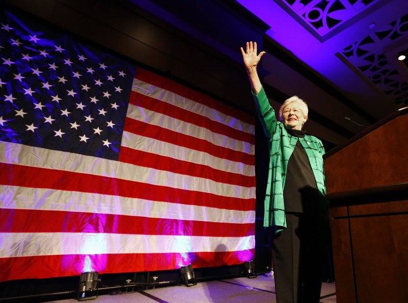 FILE - In this Nov. 6, 2018, file photo, Alabama Gov. Kay Ivey waves to supporters after she won the election at a watch party, in Montgomery, Ala. (AP Photo/Butch Dill, File)