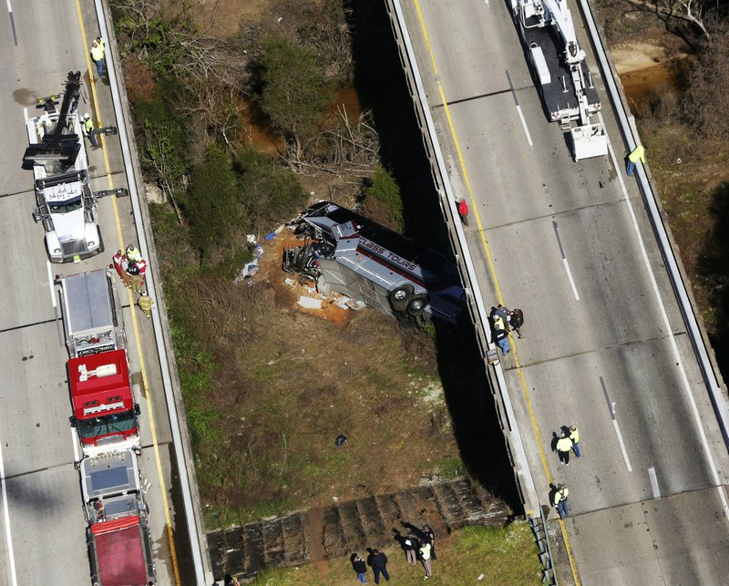 FILE - In this Tuesday, March 13, 2018, file photo, rescue crews work at the scene of a deadly charter bus crash, in Loxley, Ala. (AP Photo/Dan Anderson, File)