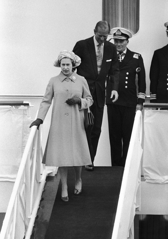 FILE - In this file photo dated Thursday, May 25, 1978, Britain's Queen Elizabeth II and Prince Philip leave the Royal Yacht Britannia for a stopover in Bremerhaven, on her state visit to West Germany. (AP Photo/FILE)