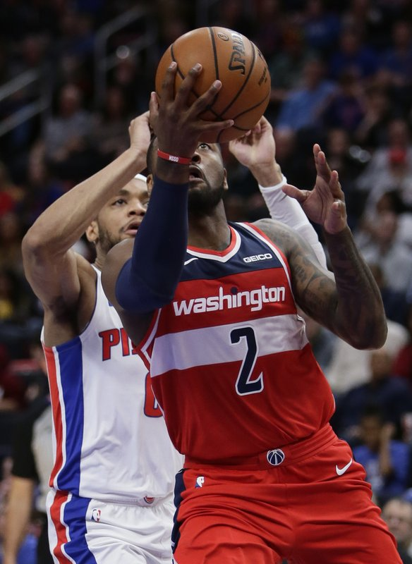 Washington Wizards guard John Wall (2) goes to the basket past Detroit Pistons guard Bruce Brown during the second half of an NBA basketball game Wednesday, Dec. (AP Photo/Duane Burleson)