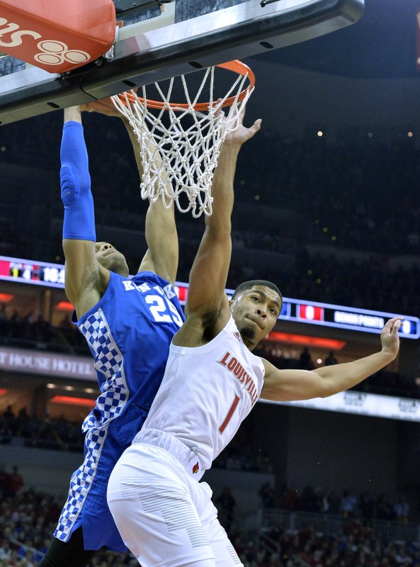 Kentucky forward PJ Washington (25) goes in for a dunk over the defense of Louisville guard Christen Cunningham (1) during the first half of an NCAA college basketball game in Louisville, Ky. (AP Photo/Timothy D. Easley)