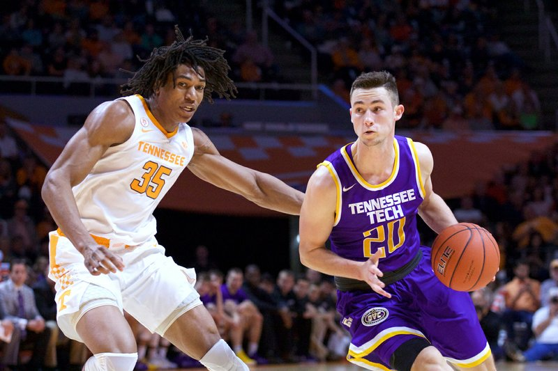 Tennessee Tech guard Hunter Vick (20) brings the ball down court against Tennessee forward Yves Pons (35) in the first half of an NCAA college basketball game Saturday, Dec. (AP Photo/Shawn Millsaps)