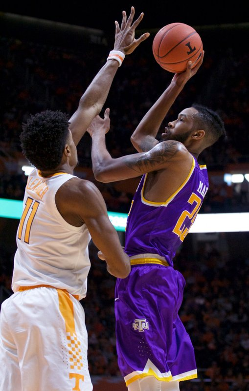 Tennessee Tech forward Malik Martin (25) attempts a shot against Tennessee forward Kyle Alexander (11) in the first half of an NCAA college basketball game Saturday, Dec. (AP Photo/Shawn Millsaps)