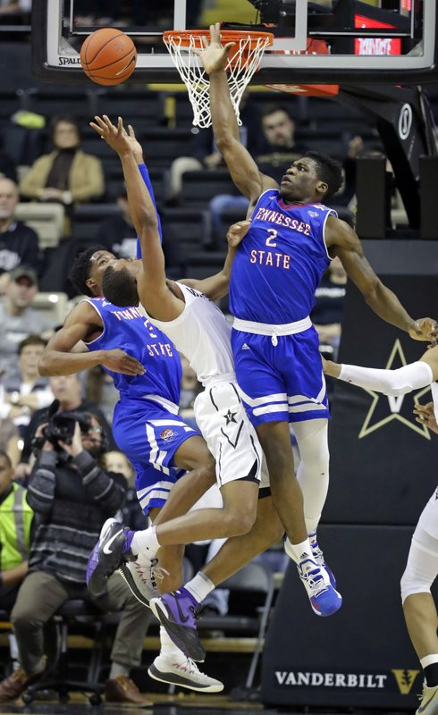 Vanderbilt guard Joe Toye, center, shoots between Tennessee State's Donte Fitzpatrick-Dorsey (3) and Emmanuel Egbuta (2) in the first half of an NCAA college basketball game Saturday, Dec. (AP Photo/Mark Humphrey)