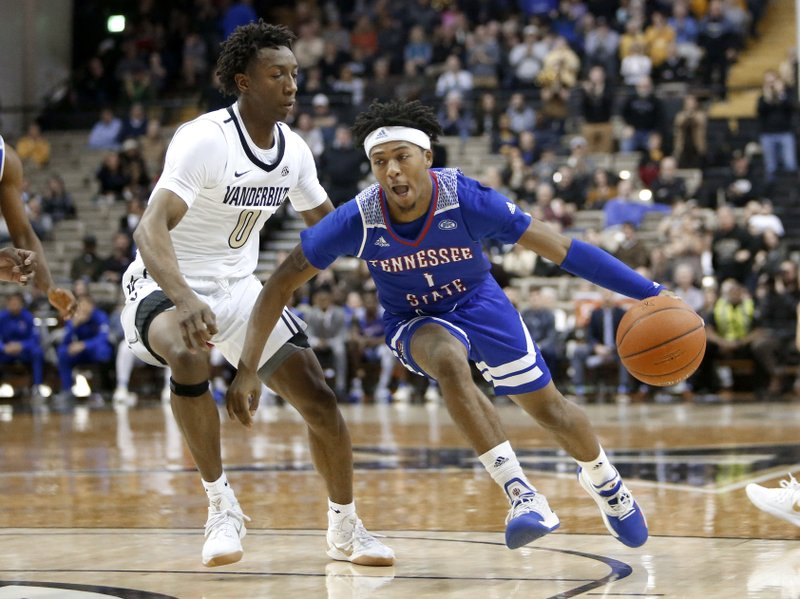 Tennessee State guard Michael Littlejohn (1) drives against Vanderbilt guard Saben Lee (0) in the first half of an NCAA college basketball game Saturday, Dec. (AP Photo/Mark Humphrey)