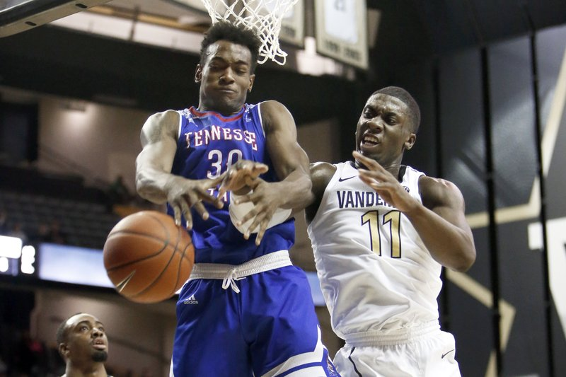 Tennessee State forward Stokley Chaffee Jr. (30) and Vanderbilt forward Simisola Shittu (11) battle for a rebound in the first half of an NCAA college basketball game Saturday, Dec. (AP Photo/Mark Humphrey).