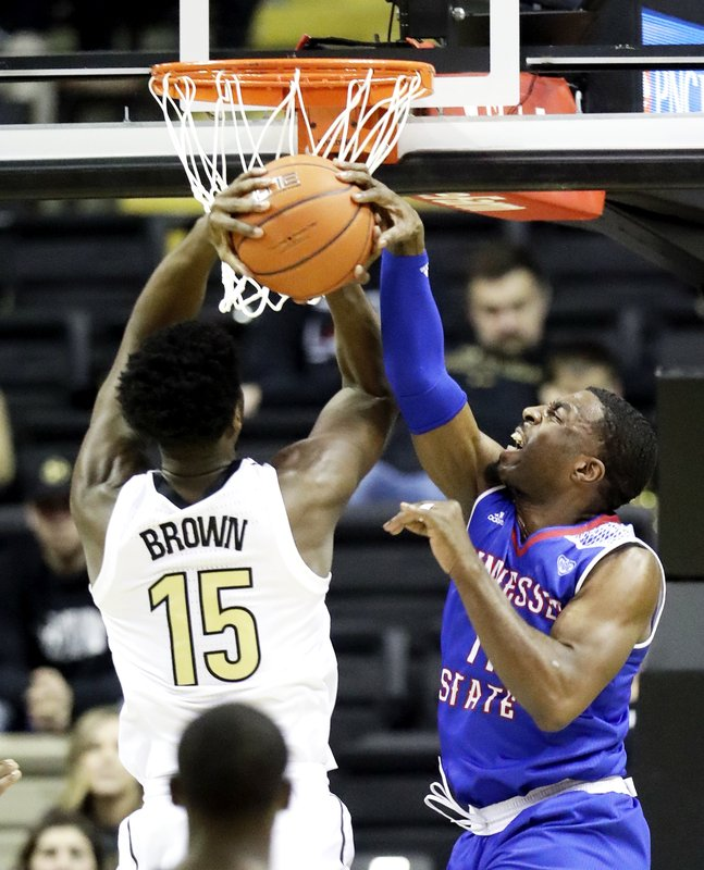 Vanderbilt forward Clevon Brown (15) shoots against Tennessee State guard Kamar McKnight in the first half of an NCAA college basketball game Saturday, Dec. (AP Photo/Mark Humphrey)